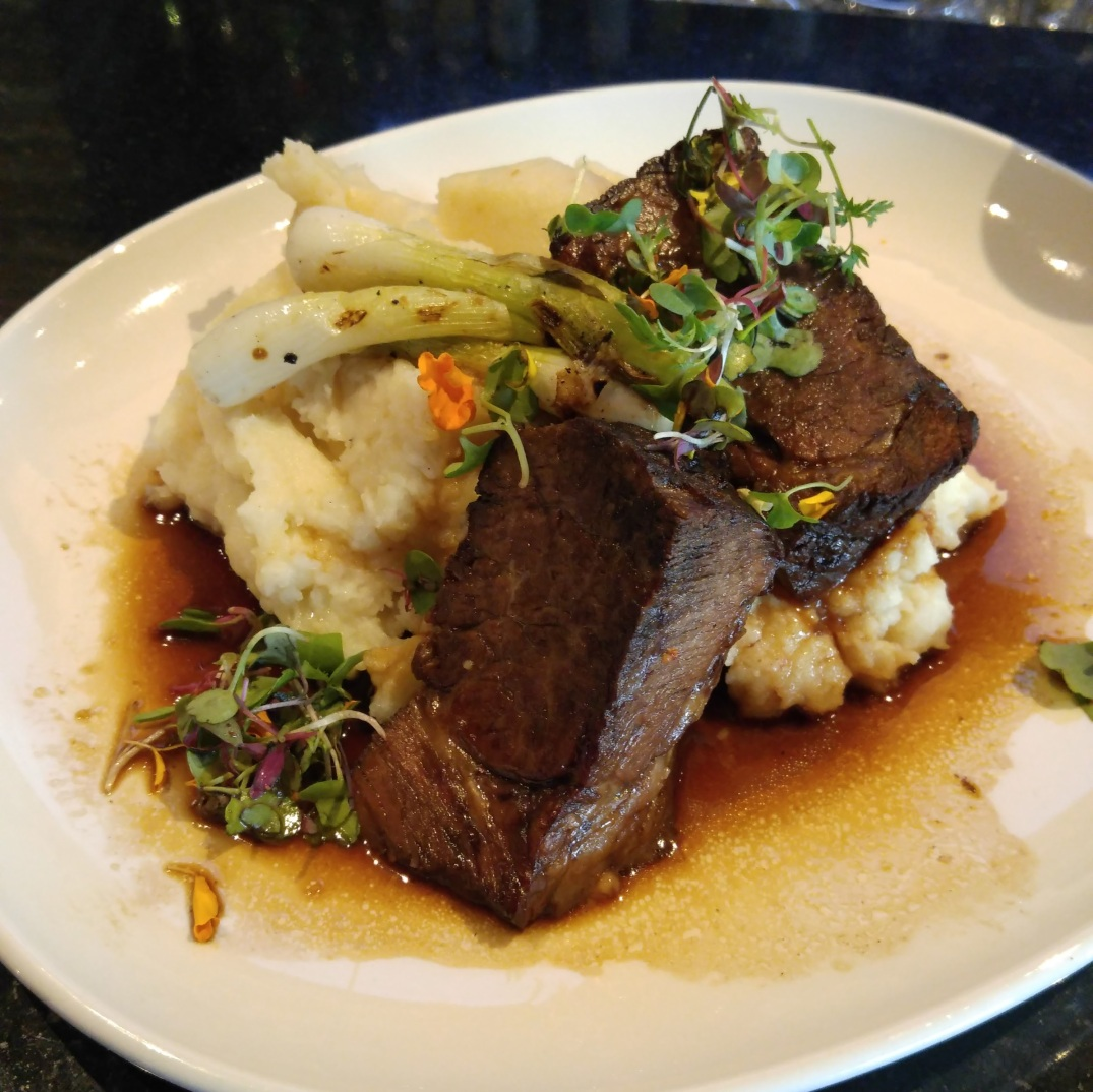 Braised shortrib with horseradish mash, grilled scallions, and red wine demi-glace