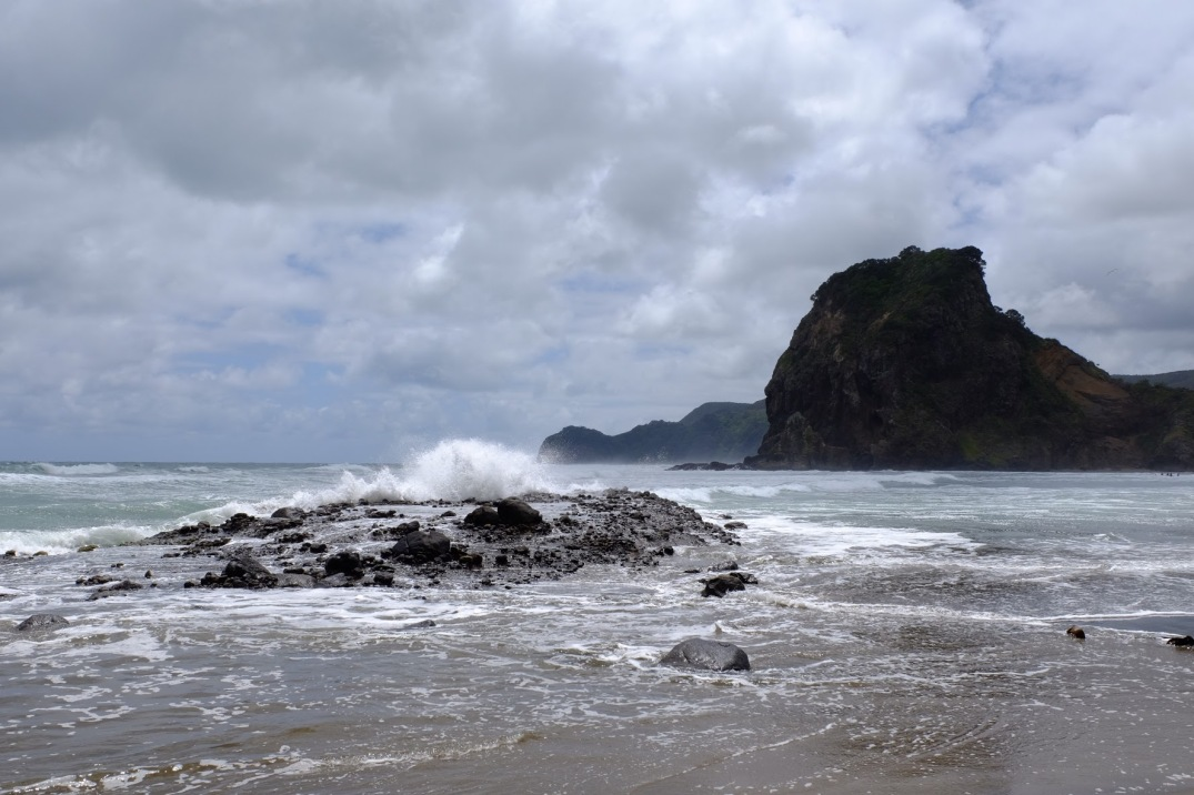 Crashing waves with Lion Rock in the distance